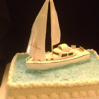 Groom's Sailboat Boat made from cake covered partially in fondant, sail from wafer paper.