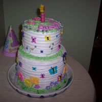 "Butterflies For Olivia 1 year old birthday cake. Top cake is 6"" smash cake : )"
