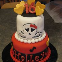 Girly Skull All fondant, for 16 year old's birthday. They provided the picture so I dont know who to credit for the idea. This was a fun cake