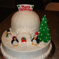 Igloo With Penguins Made this for my family christmas party.. First time molding figures from fondant/gumpaste.. They turned out sooo cute.. and then my nephew...