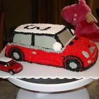 Mini Cooper Chocolate cake with buttercream... I started with the 3D cruiser from Wilton and did some carving and stacking to get the longer shape......