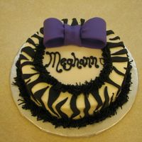 "Meghann's Cake The customer had asked for a very small ""token"" cake, something with animal print and purple. There were a couple of cakes that I..."