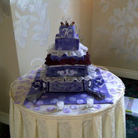 "Victorian Went for classic Victorin elegance..Each tier is a different nflavor cake.Bride was wow""d"