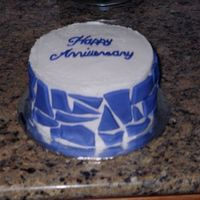 Anniversary Cake I made this cake for my dh and me for our 2nd wedding anniversary. This was a 6 in lemon cake frosted in buttercream with purple fondant...