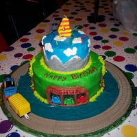 Thomas The Tank Engine   2 tier cake, all buttercream, airbrushed with Thomas rings and track around the cake.