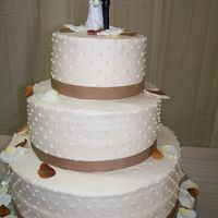 Ashley 3 Tier Round Wedding with fall colors, fabric ribbon and petals.
