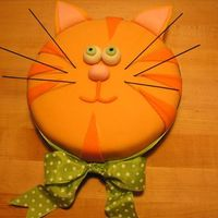 Orange Tabby Cat Cake Everything on this cake is edible except for the green polka-dot bow, which is actual ribbon. The whiskers are make of thin spaghetti that...