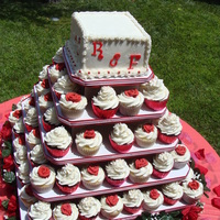 Red And White Cupcake Tree Top cake was a 6 inch square Coconut Vanilla bean cake with fresh strawberries. Butter cream frosting, fondant letters. The cupcakes are...