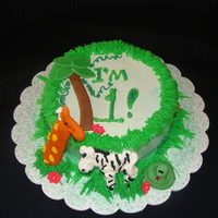 Zachary's Smash Cake 6 inch vanilla cake with whipped frosting, fondant accents and royal icing animals