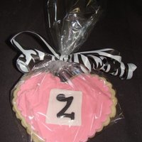 Zoey's Cookies NFSC with fondant accents... These were the favors for a baby shower. They matched the zebra baby shower cake.