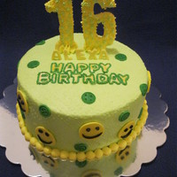 "Happy 16Th Birthday 8"" round, chocolate cake, neon green, with smiley faces and a candy ""16"""