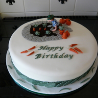 Gardening Cake A birthday cake i made for a friend, sponge cake with claydough man, all vegetables are fondant,