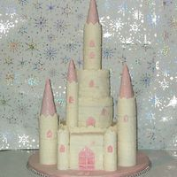 Charlies 21St Cake My first stacked cake, and attempt at a castle. the paste broke a little on one tier, and i ran out of time to redo it. top and bottom...