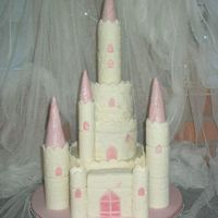 Tiered Cake Fantasy Castle my first tiered cake, 2 tier sponge, buttercream one chocolate , made for my daughters birthday.