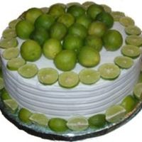 Key Lime Cake Simple buttercream cake with a designed side and key lime decorations.