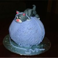 Cat With Yarn I took this idea from Debbie Brown's 50 Easy Party Cakes. I now wish I had taken the time to make the yarn out of mmf but the effect...