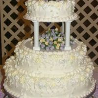 First Wedding Cake 2 Here's a better picture of the cake. Hopefully you can see the details a little clearer.