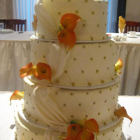 Orange Sunset This cake was delivered in a horrendous rainstorm. I can't believe it survived the trip!It took me twice as long to arrive at the...