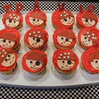 Pirate Themed Cupcakes For A Baby Boy WASC with mango filling, iced in buttercream. All pirate decorations are made from gumpaste.