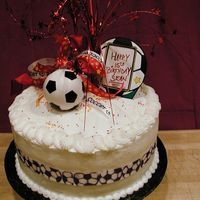 Soccer Themed Cake For 15 Yr. Old Soccer Player Boy.   Four layer cake, iced in buttercream.