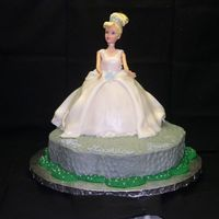 Cinderella For 3 Yr Old Birthday Cinderella is dressed in a fondant gown covered in Luster dust. Her petticoat is visible in several places. She is standing on the castle...