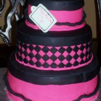 Parisene Birthday For 11 Yr Old Girl Fondant stacked cake. Chocolate cake w/chocolate mousse filling, french vanilla w/french vanilla mousse filling, and strawberry cake w/...