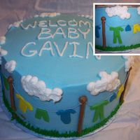 "Baby Shower Clothes Line Cake Baby shower cake .... WASC with cookies and cream filling. BC frosting with fondant ""clothes"""