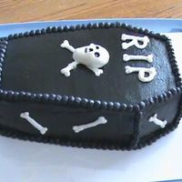 Over The Hill Coffin Cake Made this for my husband's coworker. just plain BC frosting airbrushed black.
