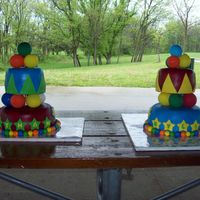 Carnival Cakes I made these for my kids turning 5 and 7. They had a big carnival birthday party. the balloons on top and between tiers are real balloons...