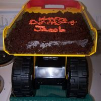 Dump Truck Cake tonka dump truck with chocolate cake and chocolate buttercream; the mom didn't want the writing very neat since it was a dump truck...