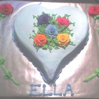 Rainbow Of Rose's  This was a chocolate heart shape cake for a little girl. Her middle name is Rose so she wanted a rainbow of roses cake. She picked her own...