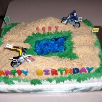 Day At The Dirt Track!  A birthday cake for the neighbor! This cake was ½ vanilla ½ chocolate. The ramps were made of cup-cake smashed...