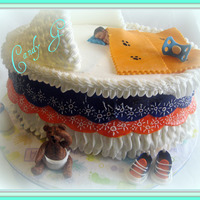 Baby Shower Colors are for Chicago Bears fan. Fondant baby, pacifier,blanket, baby shoes and teddy bear. Chocolate baby bottle. Lots of ideas from CC...