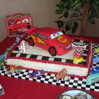 Sam's Lightening Mcqueen Birthday Cake This by far has been the most challenging cake that I have made. 1/2 sheet cake, French Vanilla and Triple Chocolate marble cake, Toba...