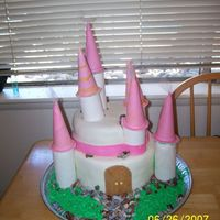 Princess Castle Cake Princess Cake with purple tulle on the tips of the towers.