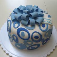 Blue Oval Birthday Cake Chocolate fudge cake with orange buttercream, covered in MMF.