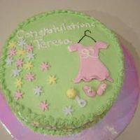 Baby Shower  I made this cake for a friend of a friend. It is buttercream and MMF. I accidently leaned into it and messed up the trim at the top, but...