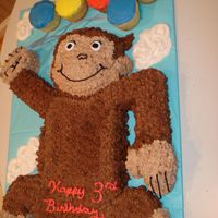 Curious George   Made out of carved cake & frosted with buttercream.
