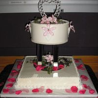 Charlie & Diane's Wedding Cake It's what they wanted, not necessarily what I would have done but it still turned out nice. Gumpaste orchids painted with luster dust...