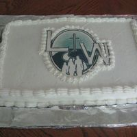 Img_0004.jpg My first sheet cake. Church logo is edible with cc icing