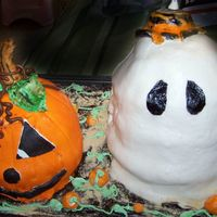 Lil 'punkin And Lil Ghosty All fondant, regular box cakes kicked up a bit...and then melted choc frosting with cookie crumbs for the 'dirt' and fondant mini...