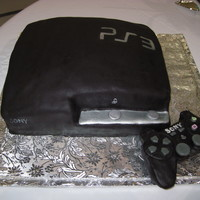 "Congratulations Rico And Kaylynn! My ""interpretation"" of a PS3 Slim! Everyone seemed to like it! Controller is fondant."