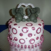 Brenda's Elephant Cake This was a shower cake for a friend's sister. The figures are all fondant. Decorations are all fondant and hand painted with lustre...