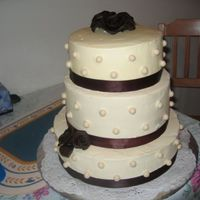 Pearls & Ribbons Anniversary Cake Mocha - chocolate marble cake iced with SMBC. Pearls are fondant & roses are candy clay.