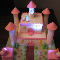 Lara's Castle Liberally dusted with all kins of edible glitter and sparkles, and with one lighted tower and 2 working spotlight