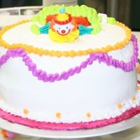 Standard Class One Clown Cake  I am finally uploading some pictures. This one was one of the first cakes they show you how to pipe. This one was done Feb or march 2006 I...