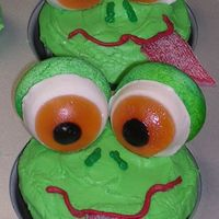 Froggy Cupcakes These are devils food with marshmallow filling, covered in green vanilla icing. The tongues are candy strips cut to size and forked on one...
