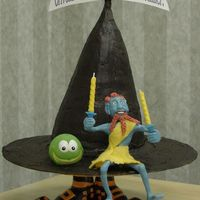Terry Pratchett's Wee Free Men This cake illustrates one of Terry Pratchett's Discworld novels, THE WEE FREE MEN. The witch hat is graduating rounds carved and iced...