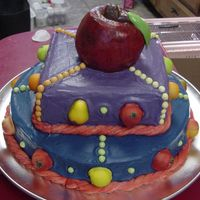 Kitchen Fruit Theme Yellow sour cream cake with buttercream filling and icing. The apple on top is two mini bundt pans and the apple was hand painted after the...