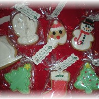 Christmas Cookies..   NFSC covered with fondant with royal icing accents..
